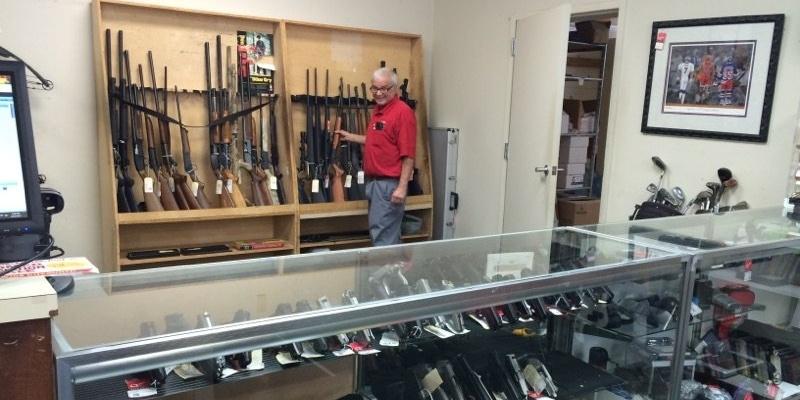 Quik-Pawn-employee-at-gun-counter-979030-edited.jpg