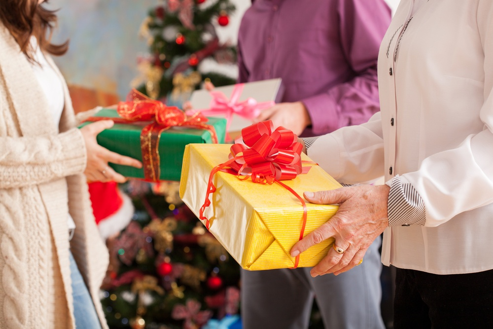 Happy family exchanging their Christmas gifts